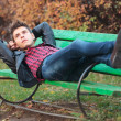 Casual man resting on a bench in the park — Stock Photo
