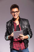 Happy young casual man with tablet — Stock Photo