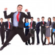 Business man jumping in front of his business team — Foto de Stock