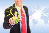 Lachende zakenman drukken op een knop licht lamp — Stockfoto