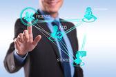 Business man pressing modern social buttons — Stock Photo