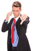 Business man with bad news on his cell phone — Stock Photo