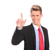 Businessman pushing an imaginary button — Stock Photo