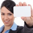 Businesswoman showing a blank business card — Stock Photo