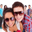 Couple in front of a  group of casual fashion — Stockfoto