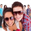 Couple in front of a  group of casual fashion — Foto de Stock