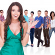 Excited woman in front of a group of casual — Stockfoto
