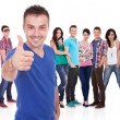 Man making the ok thumbs up gesture in front of his firends — Foto Stock