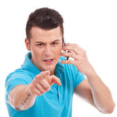 Casual man pointing angrily at camera — Stock Photo