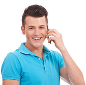 Young casual man speaking on cellphone — Stock Photo