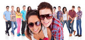 Couple in front of a group of casual fashion — Stock Photo