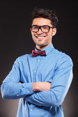 Young casual man with glasses smiling — Stock Photo
