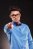 Fashion man wearing bow tie pointing — Stock Photo