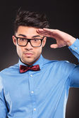 Casual fashion man making a military salute — Stock Photo