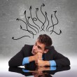 Man sitting at his desk with his mind in all directions — Stock Photo #19608511
