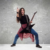 Rocker making a rock and roll gesture — Stock Photo