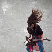 Headbanging electric guitar player — Stock Photo