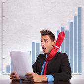 Business man with flying tie reading the good news — Stock Photo
