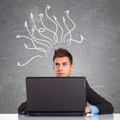 Business man using laptop thinking — Stock Photo