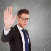 Serious business man showing stop — Stock Photo