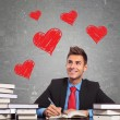 Business man writting a love letter — Stockfoto