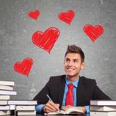 Obchodní muž píše milostný dopis — Stock fotografie