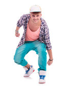 Dancer posing crouched — Stock Photo