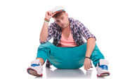 Dancer on the floor holding his hat — Stock Photo
