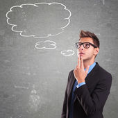 Thinking man with speech bubble — Stock Photo