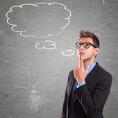 Thinking man with speech bubble — Stock Photo