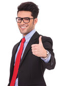 Man showing thumbs up gesture — Stock Photo