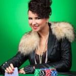 Sexy girl smiles at poker table — Stock Photo #21939693