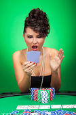 Woman looking amazed at cards — Stock Photo