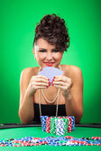 Woman stays at poker table — Stock Photo