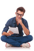 Seated man holds a tablet — Stock Photo