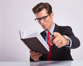 Reading a book & pointing — Stock Photo