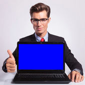 Business man with laptop & thumb up — Stock Photo