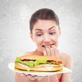 To eat or not to eat a big sandwitch — Stock Photo