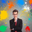 Man with color splashes around him - Foto Stock