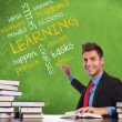 Man writes learning concepts - Stock Photo