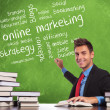 Man writes online marketing concepts - Stock Photo