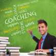 Man writes coaching concepts - Stock Photo