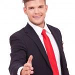Business man offers handshake — Stock Photo #24246009