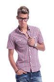 Casual man unbuttoning shirt — Stock Photo