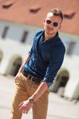 Casual man walking in city — Stock Photo