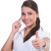 Casual woman thumb up & phone — Stock Photo