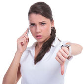 Casual woman on phone thumb down — Stock Photo