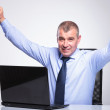 Old business man cheers from behind laptop — Stock Photo