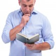 Casual middle aged man reading attentive — Stock Photo #26353589