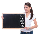 Casual woman with chalk & board — Stock Photo